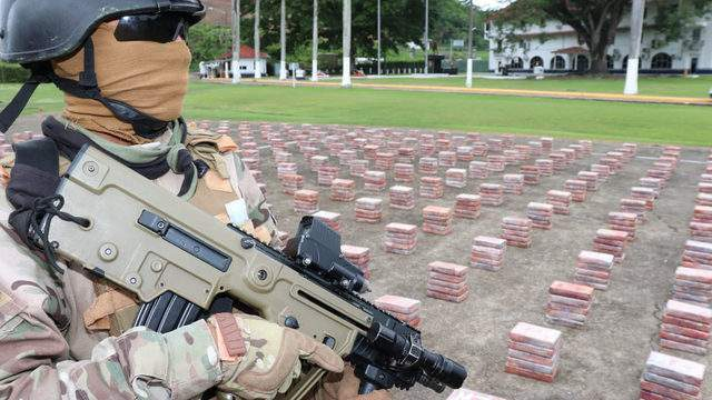 A Panamanian soldier guards the cocaine found inside a shipping container. Photo courtesy of Panamanian authorities