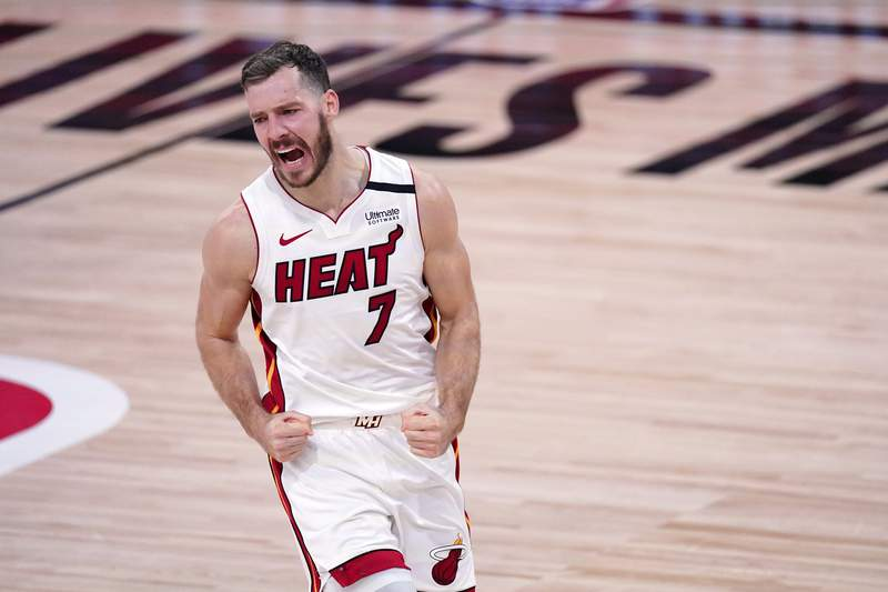 Miami Heat guard Goran Dragic (7) celebrates after sinking a basket against the Boston Celtics during the second half of an NBA conference final playoff basketball game, Thursday, Sept. 17, 2020, in Lake Buena Vista, Fla. (AP Photo/Mark J. Terrill)