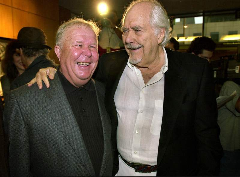"""FILE - In this Thursday, June 22, 2000, file photo, director-producer Robert Altman, right, laughs with actor Ned Beatty prior to the 25th anniversary screening of """"Nashville,"""" at the Academy of Motion Picture Arts and Sciences in Beverly Hills, Calif. Beatty portrayed Delbert Reese in Altman's film. Beatty, the indelible character actor whose first film role, as a genial vacationer brutally raped by a backwoodsman in 1972s Deliverance, launched him on a long, prolific and accomplished career, died Sunday, June 13, 2021. He was 83. (AP Photo/Michael Caulfield, File)"""