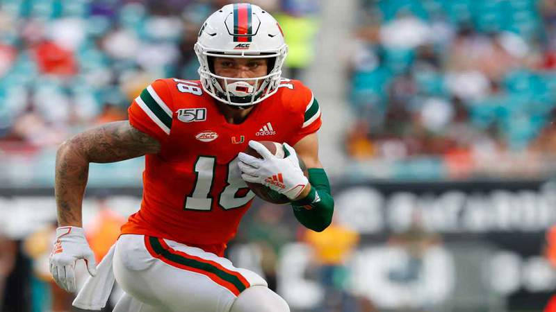Miami Hurricanes quarterback Tate Martell runs with the football during the first half against Bethune-Cookman, Sept. 14, 2019, in Miami Gardens, Florida.