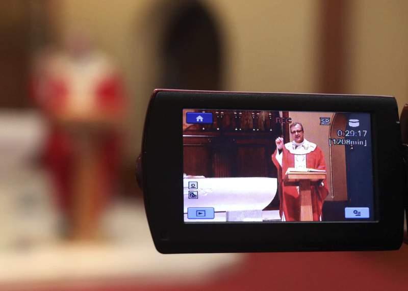 Church services livestreaming during Coronavirus. (Associated Press photo)