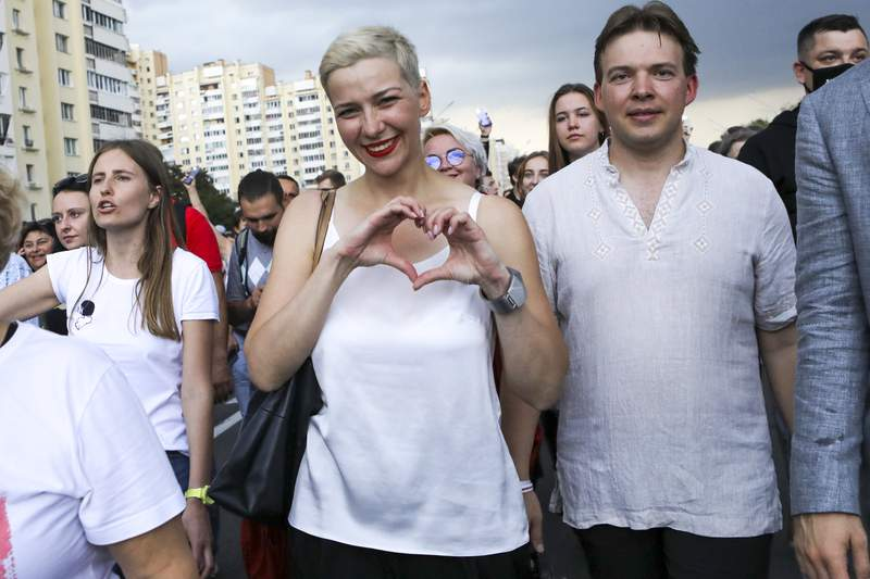 FILE - In this Aug. 30, 2020, file photo, Maria Kolesnikova, one of Belarus' opposition leaders, center, gestures, during a rally in Minsk, Belarus.  Authorities in Belarus detained a lawyer representing a top opposition activist who was jailed this month amid mass protests against the countrys authoritarian president, who won a sixth term in a disputed election. The lawyer, Lyudmila Kazak, went missing on Thursday, Sept. 24, 2020 with police confirming later in the day that she had been detained. Kazak was defending Maria Kolesnikova, a key member of a council Belarus political opposition set up to push for a new presidential election.  (AP Photo/File)