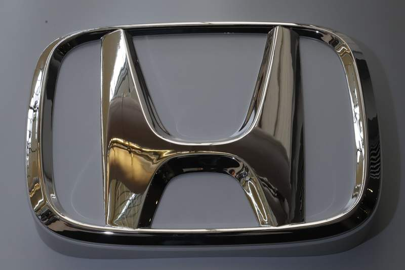 The Honda logo is seen on display at the 2020 Pittsburgh International Auto Show, Thursday, Feb. 13, 2020, in Pittsburgh. Honda is recalling over 1.4 million vehicles in the U.S. to repair drive shafts that can break, window switches that can overheat and a software flaw. (AP Photo/Gene J. Puskar)