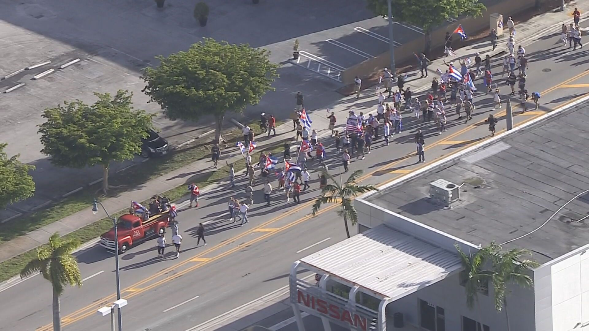 A few dozen SOS Cuba protesters marched Friday evening on Eighth Street in Miami's Little Havana.