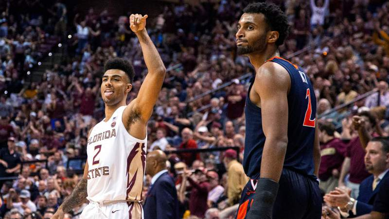 Florida State guard Anthony Polite and Virginia guard Braxton Key both react to Polite's 3-point shot during the second half of a game in Tallahassee, Florida, Jan. 15, 2020. The Seminoles beat the Cavaliers 54-50.