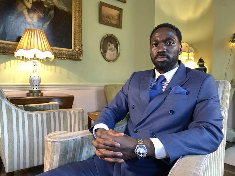 Moses Swaibu poses for a photograph during an interview with the Associated Press in London, Monday, Dec. 7, 2020. A former professional soccer play who was jailed in 2015 for match fixing allegations fears the financial crisis in the game caused by the coronavirus could make players more vulnerable to taking bribes. Moses Swaibu tells The Associated Press a match fixer has a potential pool of people he can manipulate.