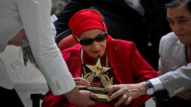 In this March 20, 2019 file photo, Cuba's Prima Ballerina Alicia Alonso receives the Star of the Century award from the Latin Music Institute in recognition of her contribution to ballet and culture, during a ceremony in Havana, Cuba.