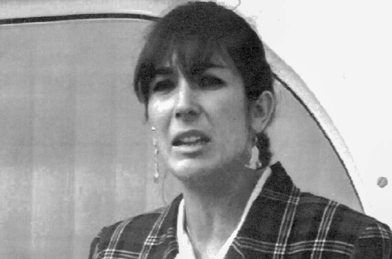 FILE - In this Nov. 7, 1991, file photo, Ghislaine Maxwell, daughter of late British publisher Robert Maxwell, reads a statement expressing her family's gratitude to Spanish authorities after recovery of his body.   Jeffrey Epsteins former girlfriend Ghislaine Maxwell has been held in U.S. jail since July 2020, and her brother Ian Maxwell said Wednesday March 10, 2021, she should be released on bail, claiming that she was being held in degrading conditions that amount to torture.  (AP Photo/Dominique Mollard, File)