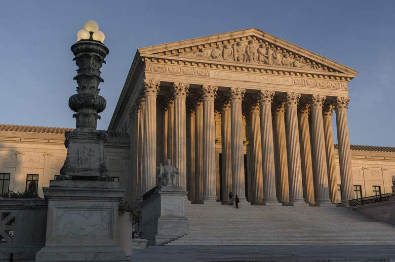 In this Nov. 6, 2020 photo, The Supreme Court is seen as sundown in Washington. (AP Photo/J. Scott Applewhite)