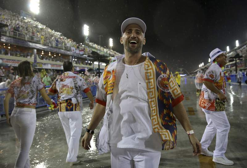In this Feb. 15, 2015 photo, comedian and actor Paulo Gustavo participates in the Carnival parade at the Sambadrome in Rio de Janeiro, Brazil. The popular comedian died in a Rio hospital from complications related to COVID-19. He was 42. (AP Photo/Bruna Prado)