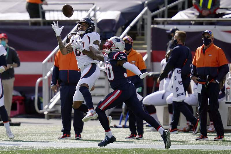 Denver Broncos wide receiver Tim Patrick (81) catches a pass as New England Patriots cornerback Jason McCourty (30) defends in the first half of an NFL football game, Sunday, Oct. 18, 2020, in Foxborough, Mass. (AP Photo/Charles Krupa)