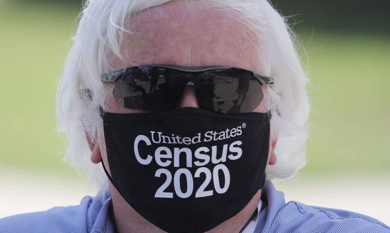 Amid concerns of the spread of COVID-19, census worker Ken Leonard wears a mask as he mans a U.S. Census walk-up counting site set up for Hunt County in Greenville, Texas, Friday, July 31, 2020. (AP Photo/LM Otero)