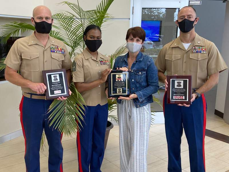 From left to right: Lt. Col. Charles Larson III, First Sgt. Terika King, Local 10's Mayte Padron, and Lt. Col. Ian Garvey.