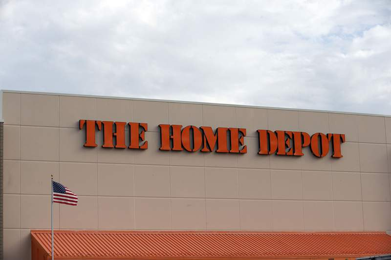 FILE - In this Aug. 27, 2019 file photo, the Home Depot logo is shown on a store in Bloomington, Minn. Home Depots fiscal second-quarter sales surged to easily top Wall Streets expectations as consumers continued working on home projects and gardening amid the coronavirus outbreak.  (AP Photo/Jim Mone, File)