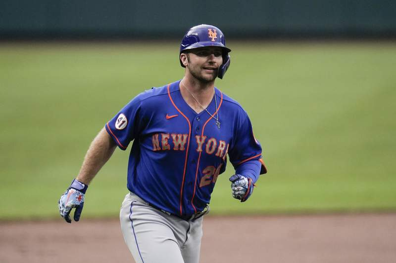 New York Mets' Pete Alonso runs the bases after hitting a two-run home run off Baltimore Orioles starting pitcher Matt Harvey during the first inning of a baseball game, Wednesday, June 9, 2021, in Baltimore. Mets' Francisco Lindor scored on the home run. (AP Photo/Julio Cortez)