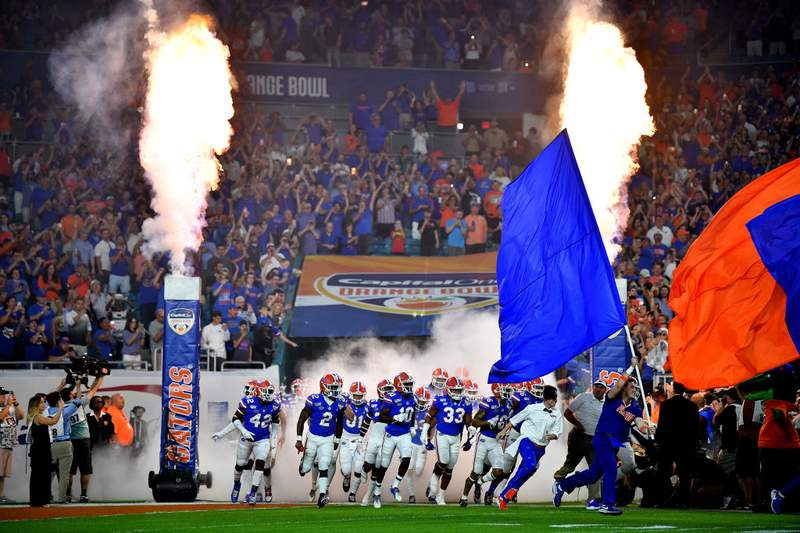 Florida Gators take the field prior to the Capital One Orange Bowl against the Virginia Cavaliers at Hard Rock Stadium on December 30, 2019 in Miami, Florida. (Photo by Mark Brown/Getty Images)