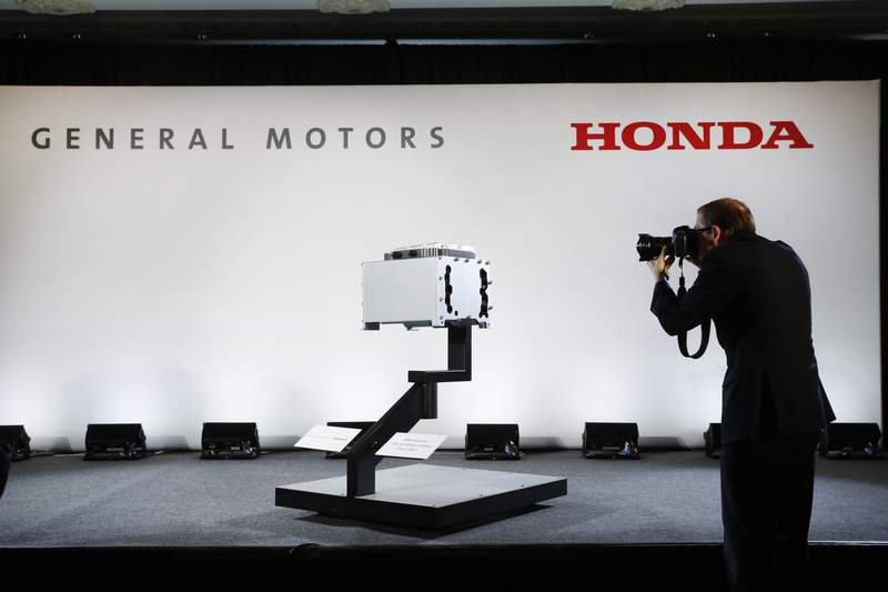 FILE -In this Jan. 30, 2020 file photo, a photographer captures images of the General Motors-Honda Next Generation Fuel Cell after a news conference in Detroit. On Thursday, Sept. 3, General Motors and Honda say they have signed a deal to explore sharing vehicle underpinnings and propulsion systems in North America. The companies say planning discussions on jointly designed vehicles will start immediately and include vehicles powered by both electricity and internal combustion engines. (AP Photo/Paul Sancya)