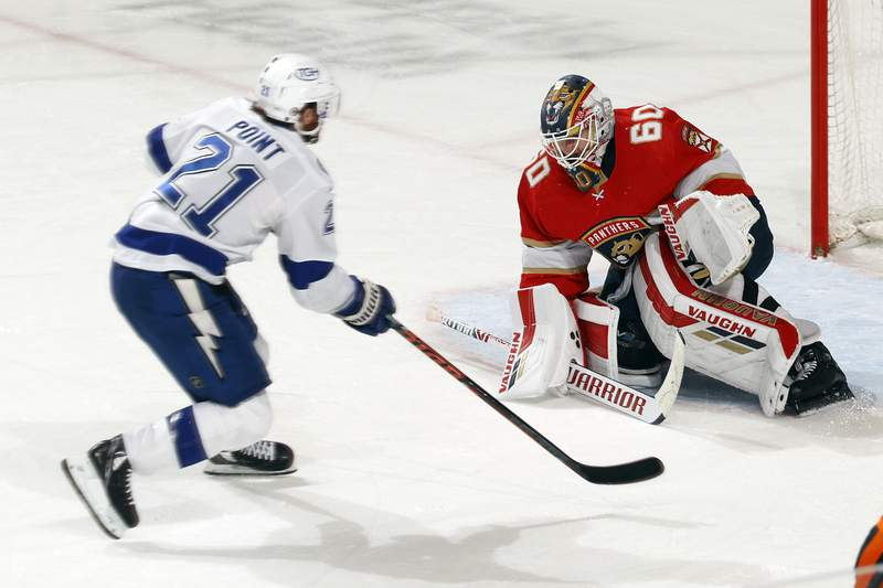 Chris Driedger of the Florida Panthers stops a third period shot by Brayden Point of the Tampa Bay Lightning at the BB&T Center on May 10, 2021 in Sunrise, Florida.