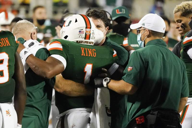 Miami quarterback D'Eriq King (1) is taken off the field after he was injured during the first half of the Cheez-it Bowl NCAA college football game against Oklahoma State, Tuesday, Dec. 29, 2020, in Orlando, Fla. (AP Photo/John Raoux)