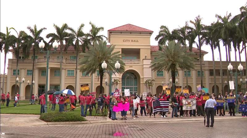 City of Miramar employees gather outside city hall to protest furloughs