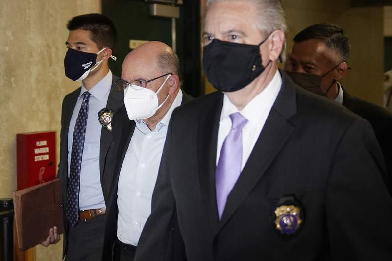 The Trump Organization's Chief Financial Officer Allen Weisselberg, second from left, arrives to a courtroom in New York, Thursday, July 1, 2021. Donald Trumps company and its longtime finance chief were charged Thursday in what a prosecutor called a sweeping and audacious tax fraud scheme that saw the Trump executive allegedly receive more than $1.7 million in off-the-books compensation, including apartment rent, car payments and school tuition.(AP Photo/Seth Wenig)