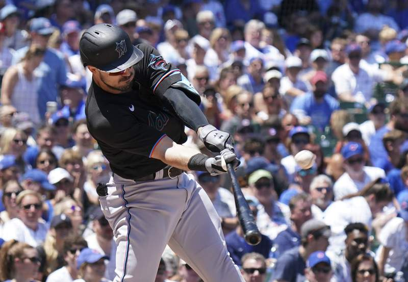 Adam Duvall of the Miami Marlins hits a two-run home run during the first inning of a game against the Chicago Cubs at Wrigley Field on June 19, 2021 in Chicago, Illinois.