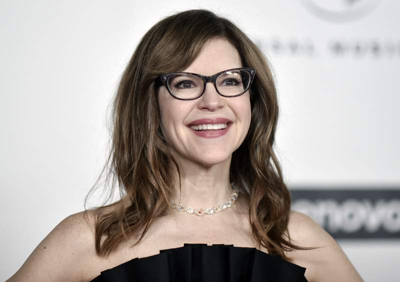 FILE - Grammy Award-winner Lisa Loeb attends the Universal Music Group 2020 Grammy after party in Los Angeles on Jan. 26, 2020. Loeb was inspired to capture the weirdness, wonder and horror of 2020 during a Brown University online reunion. She tapped dozens of her fellow alumni to create Together Apart, a collection of 10 mini-musicals that capture a year online. (Photo by Richard Shotwell/Invision/AP, File