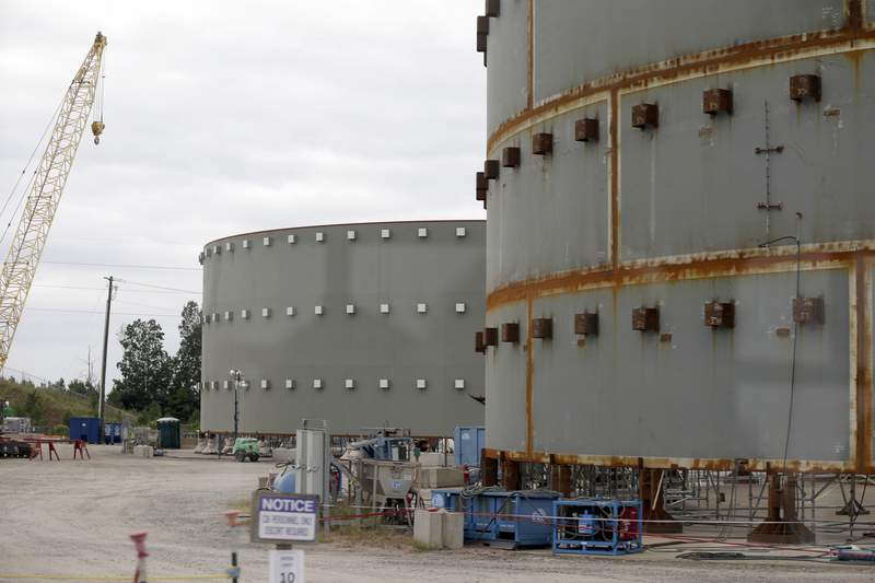 FILE - In this Sept. 21, 2016 file photo, parts of a containment building for the V.C. Summer Nuclear Station is shown near Jenkinsville, S.C., during a media tour of the facility. A former official for the contractor hired to build two nuclear reactors at the V.C. Summer plant that were never completed, pleaded guilty Thursday, June 10, 2021, to lying to federal authorities.(AP Photo/Chuck Burton, File)