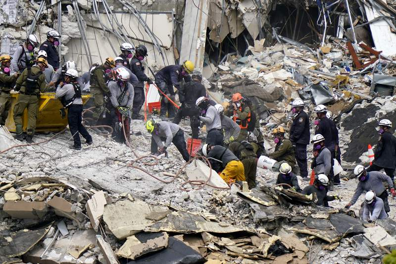 Crews from the United States and Israel work in the rubble Champlain Towers South residential condo, Tuesday, June 29, 2021, in Surfside, Fla. Many people were still unaccounted for after Thursday's fatal collapse. (AP Photo/Lynne Sladky)