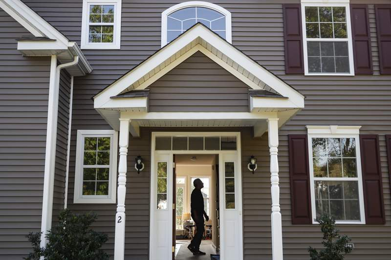 Anil Lilly tours his new home, Tuesday, July 21, 2020, in Washingtonville, N.Y. (AP Photo/John Minchillo)
